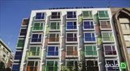 بررسی نمای سنگی، شیشه ای و رنگی در ساختمان